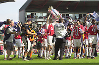 Premiership Football - Arsenal v Leicester City:.2003/04 Season - 15/05/2004  [Record breaking Season undefeated] .Robert Pires, shows the Cup to the supporters.[Credit] Peter Spurrier Intersport Images