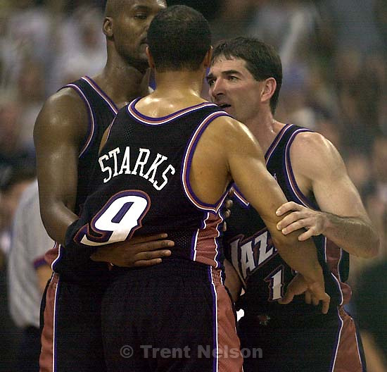 Bryon Russell and John Stockton hold back a piss-off John Starks as the Utah Jazz face the Dallas Mavericks in game four of their first round playoff series, in Dallas Tuesday.  05/01/2001<br />