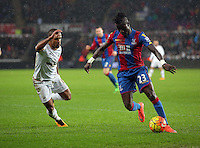 (L-R) Wayne Routledge of Swansea against Pape Souare of Crystal Palace during the Barclays Premier League match between Swansea City and Crystal Palace at the Liberty Stadium, Swansea on February 06 2016