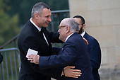 Lawyer for United States President Donald J. Trump, Rudy Giuliani, right, greets Ukrainian politician and Mayor of Kiev Vitali Klitschko as they arrive for the funeral service for late United States Senator John McCain (Republican of Arizona) at the Washington National Cathedral in Washington, DC on September 1, 2018. <br /> Credit: Alex Edelman / CNP