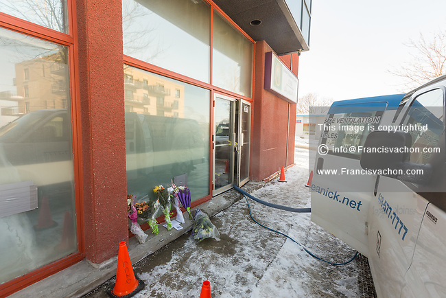 Signs, flowers, and a truck from a cleaning company are seen outside the Grande Mosquée de Quebec (Centre Culturel Islamique de Quebec), Thursday February 2, 2017. Sunday January 29, a shooter left six worshippers dead at this Quebec city mosque.