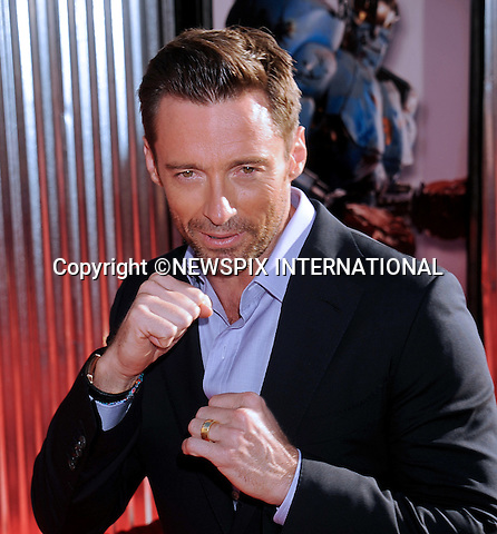 "HUGH JACKMAN.attends the World Premiere of ""Real Steel"" at the Gibson Amphitheatre, Universal City, California_02/10/2011.Mandatory Photo Credit: ©Crosby/Newspix International. .**ALL FEES PAYABLE TO: ""NEWSPIX INTERNATIONAL""**..PHOTO CREDIT MANDATORY!!: NEWSPIX INTERNATIONAL(Failure to credit will incur a surcharge of 100% of reproduction fees).IMMEDIATE CONFIRMATION OF USAGE REQUIRED:.Newspix International, 31 Chinnery Hill, Bishop's Stortford, ENGLAND CM23 3PS.Tel:+441279 324672  ; Fax: +441279656877.Mobile:  0777568 1153.e-mail: info@newspixinternational.co.uk"