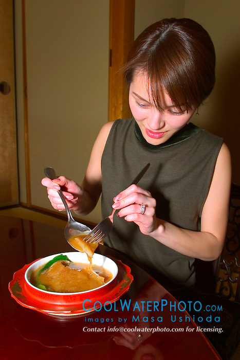 woman serving shark fin stew, made of juvenile blue shark fins, Prionace glauca, one of the most expensive Chinese cuisine, Tokyo, Japan