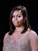 First Lady Michelle Obama smiles during the White House Correspondents' Association annual dinner on April 30, 2016 at the Washington Hilton hotel in Washington.This is President Obama's eighth and final White House Correspondents' Association.<br /> Credit: Olivier Douliery / Pool via CNP