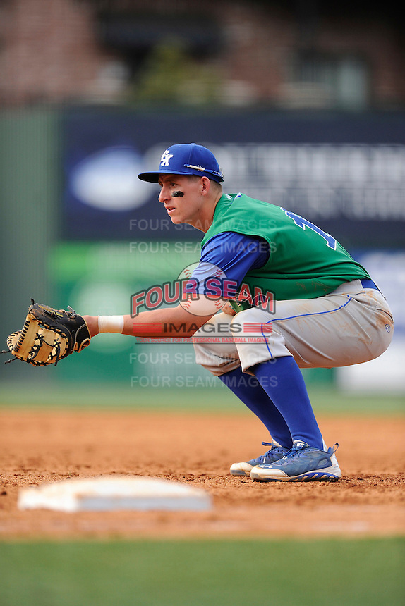 First baseman Frank Schwindel (13) of the Lexington Legends in a game against the Greenville Drive on Sunday, April 27, 2014, at Fluor Field at the West End in Greenville, South Carolina. Greenville won, 21-6. (Tom Priddy/Four Seam Images)