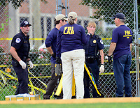 Evidence technicians from the FBI and United States Capitol Police during come scene activity after a gunman opened fire on members of Congress who were practicing for the annual Congressional baseball game in Alexandria, Virginia on Wednesday, June 14, 2017. Photo Credit: Ron Sachs/CNP/AdMedia