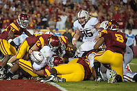 LOS ANGELES, CA - October 29, 2011:  Jeremy Steward scores for Stanford in the first overtime during Stanford's victory over the USC Trojans.   Stanford won in triple overtime, 56 -48, and extended its winning streak to 16 games.