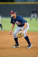 Danville Braves first baseman Juan Yepez (15) on defense against the Burlington Royals at Burlington Athletic Park on August 13, 2015 in Burlington, North Carolina.  The Braves defeated the Royals 6-3. (Brian Westerholt/Four Seam Images)