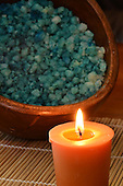 Wooden Bowl with fragrant bath salts for holistic treatment.