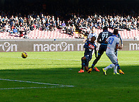 Jonathan de Guzman  shoots and scores   in action during the Italian Serie A soccer match between   SSC Napoli and Empolii    at San Paolo   stadium in Naples , December 07, 2014<br /> gol di  Jonathan de Guzman