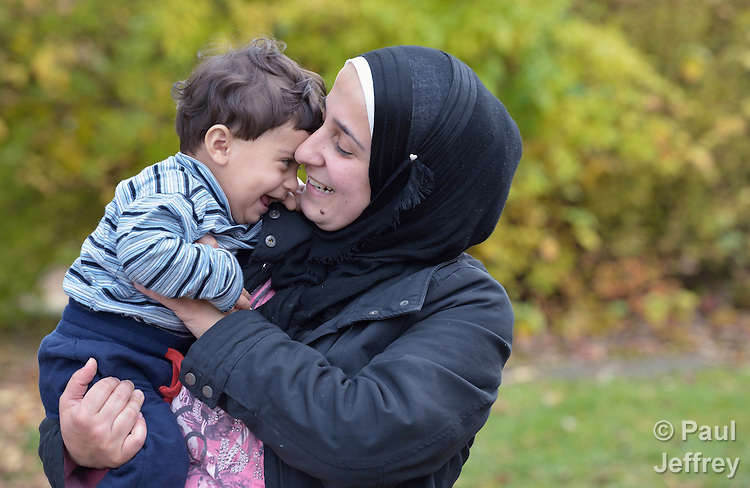 Farhan Othman holds her 9-month old son Mohammed in Messstetten, Germany. Refugees from Syria, they and their family have applied for asylum in Germany and are awaiting word on the government's decision. Meanwhile, they live in a room in a former army barracks in Messstetten.