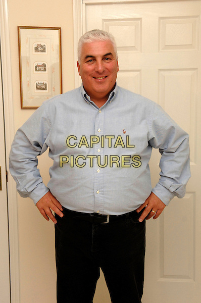 MITCH WINEHOUSE.Father of singer Amy Winehouse at His Kent Home Today..February 15th, 2007.half length blue shirt hands on hips.CAP/FIN.©Steve Finn/Capital Pictures