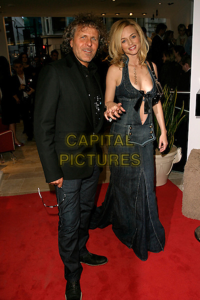 RENZO ROSSO & HEATHER GRAHAM.Diesel - store launch party, Diesel, 130 New Bond Street, London, UK..May 18th, 2006.Ref: AH.full length jean denim dress black jacket holding hands jeans.www.capitalpictures.com.sales@capitalpictures.com.© Capital Pictures.