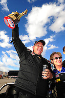 Apr. 1, 2012; Las Vegas, NV, USA: NHRA top alcohol dragster driver Jim Whiteley celebrates after winning the Summitracing.com Nationals at The Strip in Las Vegas. Mandatory Credit: Mark J. Rebilas-