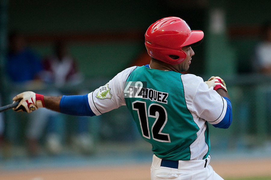 15 February 2009: Third base Michel Enriquez of the Occidentales is seen at bat during a training game of Cuba Baseball Team for the World Baseball Classic 2009. The national team is pitted against itself, divided in two teams called the Occidentales and the Orientales. The Orientales win 12-8, at the Latinoamericano stadium, in la Habana, Cuba.