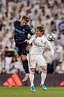 23rd November 2019; Estadio Santiago Bernabeu, Madrid, Spain; La Liga Football, Real Madrid versus Real Sociedad; Nacho Monreal (Real Sociedad)  wins the header from Luka Modric (Real Madrid)