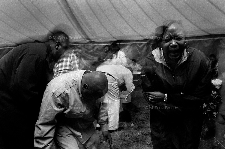 Worshippers are overcome by their religion during a christian tent revival in Great Falls, Montana.