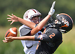 Dupo's Kyle Yancy (left) breaks up a pass to Wesclin's Kaleb Willams, drawing a flag on the play. Wesclin defeated Dupo 34-30 on Saturday August 31, 2019 in a game that was stopped Friday night at halftime due to storms. <br /> Tim Vizer/Special to STLhighschoolsports.com
