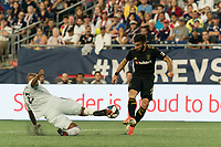 FOXBOROUGH, MA - AUGUST 4: Andrew Farrell #2 of New England Revolution tackles Diego Rossi #9 of Los Angeles FC during a game between Los Angeles FC and New England Revolution at Gillette Stadium on August 3, 2019 in Foxborough, Massachusetts.