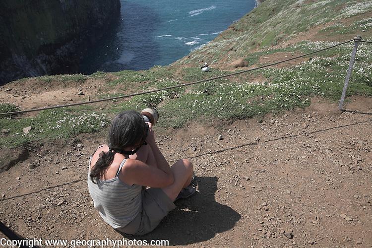 Woman photographer Skomer Island, Pembrokeshire, Wales
