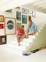 Designer Sig Bergamin and Murilo Lomas on the steps in the entrance hall of their beach house