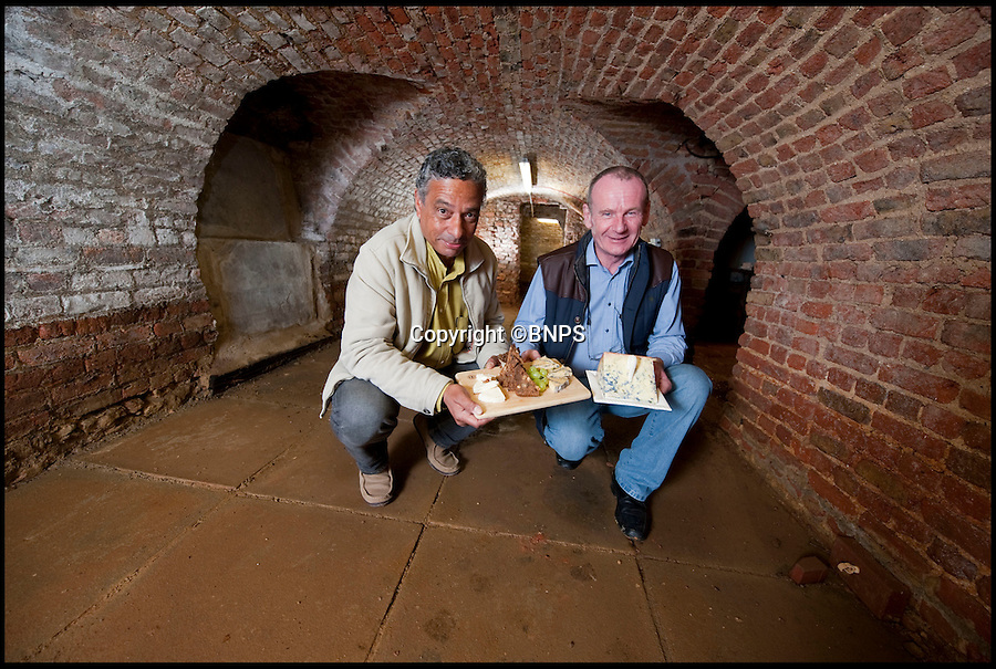 """BNPS.co.uk (01202 558833)<br /> Pic: PhilYeomans/BNPS<br /> <br /> Looks like Stilton, tastes like Stilton, Is made in Stilton....but can't be called Stilton.<br /> <br /> Historian Richard Landy(l) with Roy Baines who has recently discovered extensive 'cheese' cellars under his pub.<br /> <br /> Cheesemakers from the village which gave world-famous Stilton its name have renewed hope of overturning a law which bans them from naming their product 'Stilton'.<br /> <br /> Villagers from Stilton in Cambridgeshire were cheesed off when in 1996 it was ruled that the  product could only be made in Leicestershire, Nottinghamshire and Derbyshire.<br /> <br /> After years of kicking up a stink over the """"farcical"""" decision an application was made to Defra to get the protected designation of origin (PDO) extended to Stilton village.<br /> <br /> It was promptly dismissed despite evidence purporting to show that cheese was made in the village as far back as Roman times.<br /> <br /> But now campaigners are mounting another attempt at convincing the grand fromages in Whitehall that their cheese deserves recognition under the Stilton name.<br /> <br /> They are taking their fight to Defra minister George Eustice in the hope that their efforts have not all been in vein.<br /> <br /> Local historian Richard Landy, who for five years has spearheaded the campaign, says new evidence proves it was produced in Stilton village.<br /> <br /> Mr Landy dug up a Roman cheese mould buried in a field in the village in 2006 and has since discovered network of underground cellars thought to have been used to mature cheese.<br /> <br /> A cheese recipe was also found in letter printed in a 1726 edition of General Treatise of Husbandry and Gardening adding further weight to his plight."""