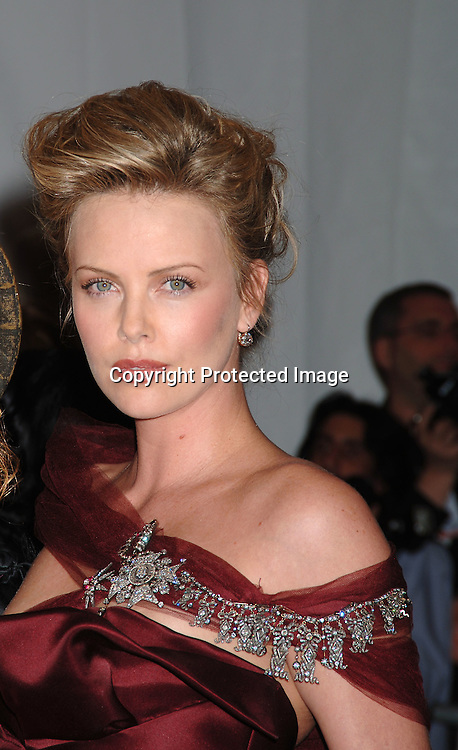 Charlize Theron ..arriving to the Costume Institute Gala celebrating AngloMania on May 1, 2006 at The Metropolitan Museum of ..Art. ..Robin Platzer, Twin Images..