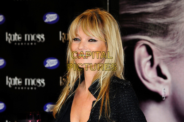 KATE MOSS.Kate Moss launches her new fragrance for women - 'Vintage Muse', Boots, Oxford Street, London, England..26th November 2010.headshot portrait fringe bangs hair black eyeliner make-up beauty smiling .CAP/CAS.©Bob Cass/Capital Pictures.