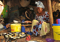 women cooking fritter at the market