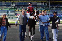 I'm Boundtoscore, with jockey Sarah Rook makes their way to the Winners Circle at Woodbine Race Course in Ontario, Canada on September 15, 2012.