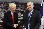 "Bank of Israel Governor Stanley Fischer (L) poses with Israeli Finance Minister Yuval Steinitz (R) after the former submitted the Bank of Israel report at the Finance Ministry in Jerusalem, Sunday, April 19, 2009. Stanley Fischer declared that ""the report says we are dealing with the current crisis relatively well"", although he did stress that he expects the decline to continue and that he believes that the Israeli economy has yet to reach its lowest point. Photo By: Emil Salman / JINI"