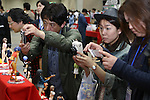 """May 3, 2010 - Tokyo, Japan - Visitors taks pictures of PVC Figurines on display during the Treasure Festa 2010 at Tokyo Big Sight, Japan, on May 4, 2010. Some visitors and hobbyists concentrate specifically on a certain type of figure, such as garage kits, gashapon, or PVC bishojo (pretty girl) statues. According to many who study the phenomenon, many 'figure moe zoku', a Japanese term which refers to """"Otaku who collect figurines"""", have difficulty in navigating modern romantic life and prefer to go on """"dates"""" with their favorite figurine during off hours."""