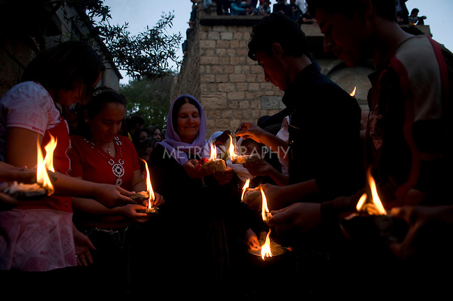LALISH VALLEY, IRAQ: Yezidis light candle wicks dipped in oil...The Yezidis, a minority religious group found in northern Iraq, celebrate Chwar Shema Sur (Red Thursday), as part of their New Year festival.  The Yezidis are the religious descendants of Zoroastrians and as a religious minority in Iraq are often targeted by terrorists.