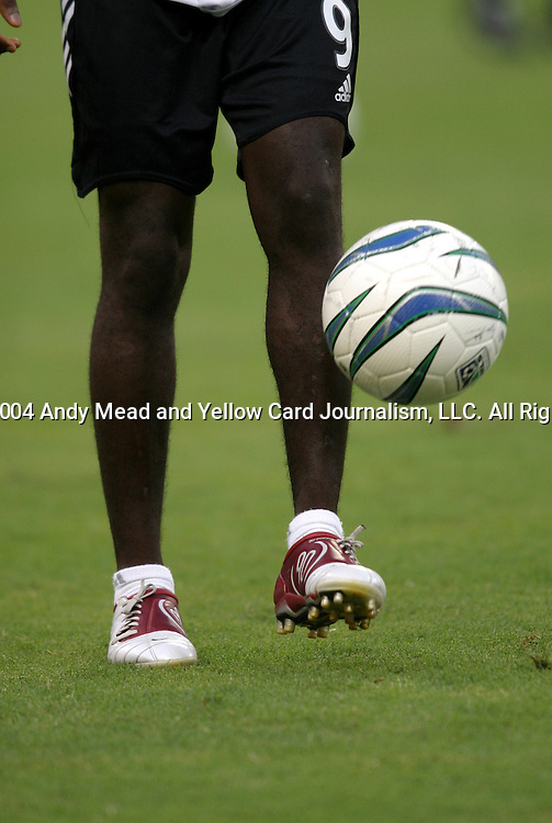 14 July 2004: Freddy Adu shows off his new shoes while juggling a ball before the game. DC United defeated Nottingham Forest of England First Division 4-3 on penalties after the teams played to a 1-1 draw at RFK Stadium in Washington, DC during an international exhibition match..