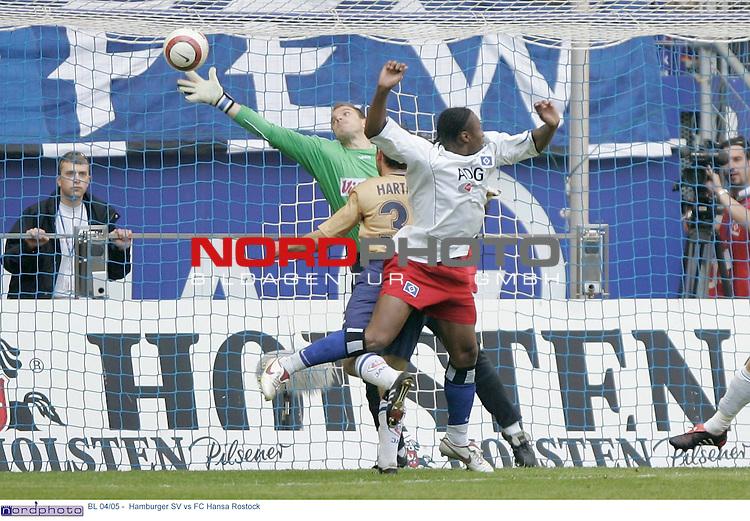 BL 04/05 -  Rueckrunde 30.Spieltag<br /> <br /> Hamburger SV vs FC Hansa Rostock<br /> <br /> Emile Mpenza schiesst das 1-0 fuer Hamburg vorbei an dem Rostocker Mathias Schober.<br /> <br /> Foto &copy; nordphoto - Anja Heinemann<br /> <br /> <br /> <br /> <br /> <br /> <br /> <br />  *** Local Caption *** Foto ist honorarpflichtig! zzgl. gesetzl. MwSt.<br /> <br /> Belegexemplar erforderlich<br /> <br /> Adresse: nordphoto<br /> <br /> Georg-Reinke-Strasse 1<br /> <br /> 49377 Vechta