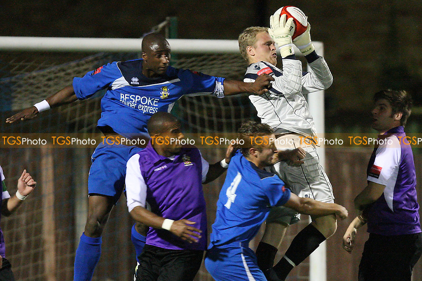 Hornchurch goalkeeper Joe Woolley rises to deny Ellis Remy - Aveley vs AFC Hornchurch - Ryman League Premier Division Football at Mill Field - 12/09/11 - MANDATORY CREDIT: Gavin Ellis/TGSPHOTO - Self billing applies where appropriate - 0845 094 6026 - contact@tgsphoto.co.uk - NO UNPAID USE.