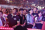 Fans watch aghast as fighters battle it out in the cage<br /><br />MMA. Mixed Martial Arts &quot;Tigers of Asia&quot; cage fighting competition. Top professional male and female fighters from across Asia, Russia, Australia, Malaysia, Japan and the Philippines come together to fight. This tournament takes place in front of a ten thousand strong crowd of supporters in Pelaing Stadium. Kuala Lumpur, Malaysia. October 2015