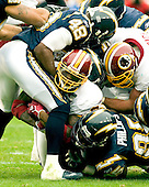 Landover, Maryland - November 27, 2005 --  visit the Washington Redskins running back Clinton Portis (26), center, is tackled by San Diego Chargers strong safety Terrence Kiel (48), top and linebacker Shaun Phillips (95) during game action at FedEx Field in Landover, Maryland on November 27, 2005.  The Chargers won the game 23 -17..Credit: Ron Sachs / CNP