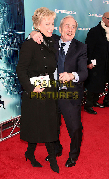 "TINA BROWN & HARRY EVANS.Attending the New York City Premiere of ""Daybreakers"" held at the SVA Theater, New York, NY, USA, 7th January 2010..full length black coat suit blue tie arm around shoulder.CAP/ADM/PZ.©Paul Zimmerman/AdMedia/Capital Pictures."