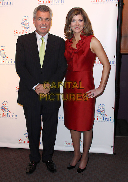 GUEST & NORAH O'DONNELL.Smile Train's 10 Year Anniversary Celebration held at Frederick P. Rose Hall, Jazz at Lincoln Center, New York, NY, USA..March 17th, 2009.full length red dress black suit hand on hip .CAP/ADM/PZ.©Paul Zimmerman/AdMedia/Capital Pictures.