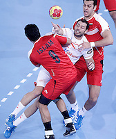 Egypt's Islam Hassan (l) and Spain's Daniel Sarmiento Melian during 23rd Men's Handball World Championship preliminary round match.January 14,2013. (ALTERPHOTOS/Acero) /NortePhoto
