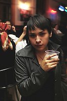 "A young woman poses for a portrait with a beer in her hand. ""Darkies"" or ""Goths"" at one of the Dada X parties in the historic center of Mexico City. August 28, 2005"