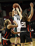 03/10/11--Tigard's Kelsey Kaelin shoots over  Oregon City defenders in the quarterfinals of girls 6A championship at the Rose Garden in Portland, Or. The Pioneers advanced to the semifinals with a score of 66-36...Photo by Jaime Valdez.........................................