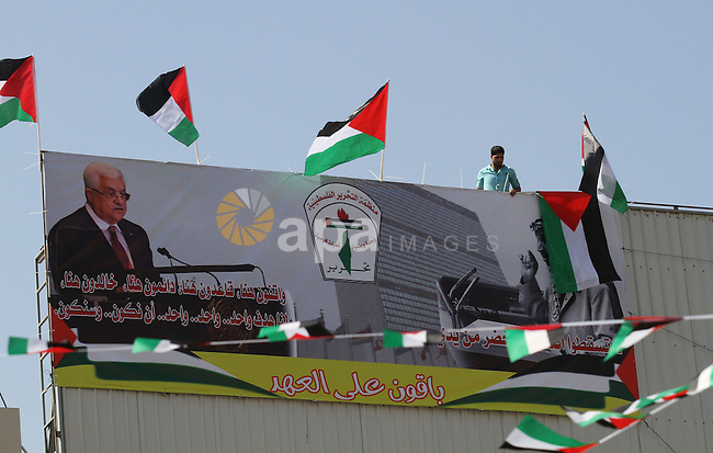 A Palestinian man stands nexto to his national flags during an event to support Palestinian President Mahmoud Abbas in the West Bank city of Nablus on September 30, 2015. Abbas has circulated a hard-hitting critique of alleged Israeli violations of the 20-year-old Oslo accords and subsequent agreements ahead of his speech to the UN general assembly in New York later on Wednesday. Photo by Nedal Eshtayah