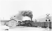 D&amp;RGW #482 is the helper engine on train of Monarch empties passing closed Poncha Junction depot westbound.<br /> D&amp;RGW  Poncha Junction, CO  7/18/1953