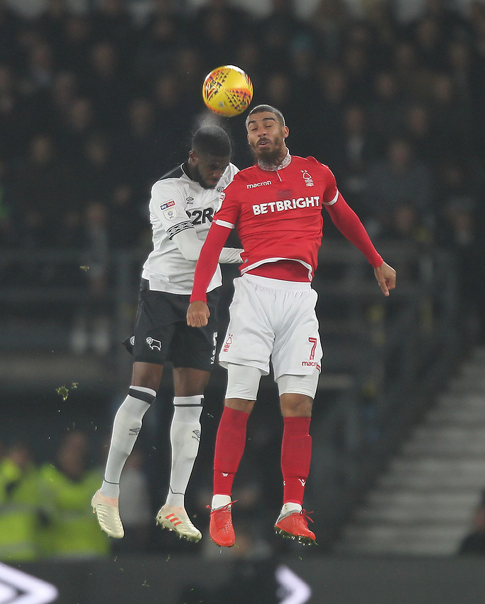 Derby County's Fikayo Tomori jumps with Nottingham Forest's Lewis Grabban<br /> <br /> Photographer Mick Walker/CameraSport<br /> <br /> The EFL Sky Bet Championship - Derby County v Nottingham Forest - Monday 17th December 2018 - Pride Park - Derby<br /> <br /> World Copyright © 2018 CameraSport. All rights reserved. 43 Linden Ave. Countesthorpe. Leicester. England. LE8 5PG - Tel: +44 (0) 116 277 4147 - admin@camerasport.com - www.camerasport.com