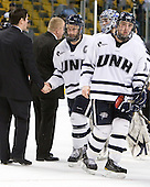 Mike Sislo (UNH - 19), Dalton Speelman (UNH - 10) - The Merrimack College Warriors defeated the University of New Hampshire Wildcats 4-1 (EN) in their Hockey East Semi-Final on Friday, March 18, 2011, at TD Garden in Boston, Massachusetts.