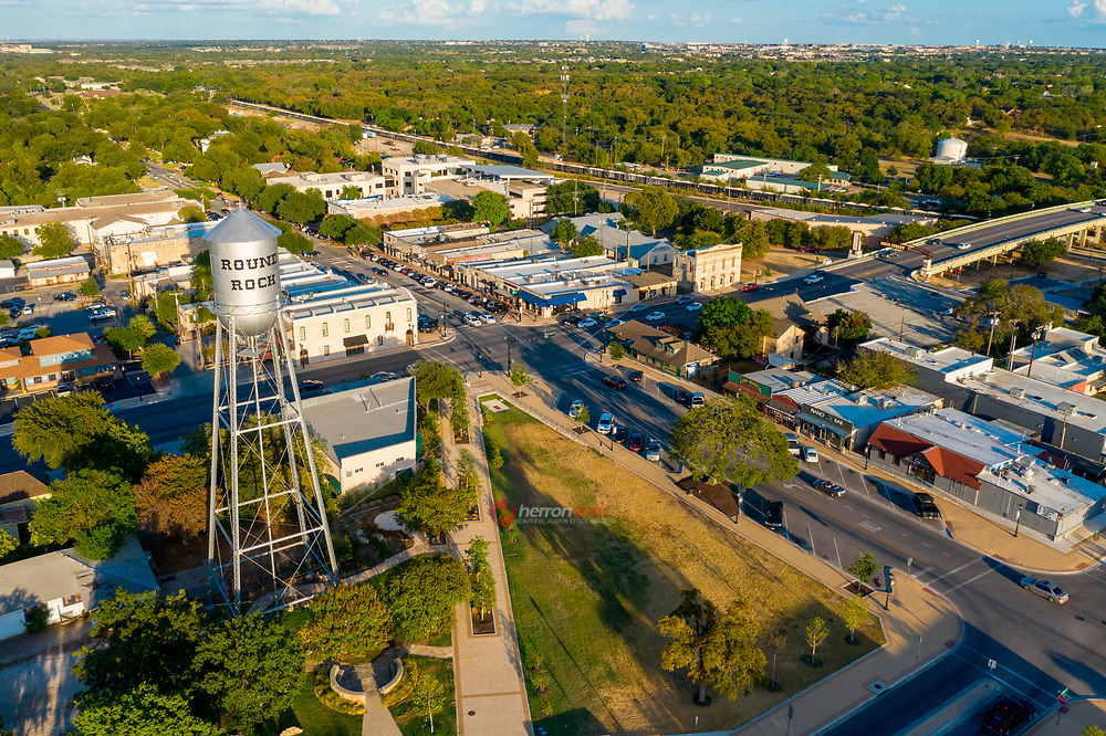 Aerial view of the Round Rock Water Tower and downtown area. The entertainment district in Downtown Round Rock is famous for live music bars, upscale and casual dining options, only the best in Texas boot scootin' nightlife around.