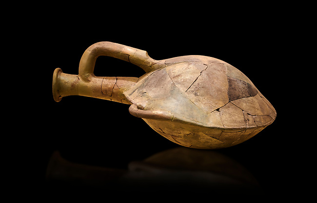 Hittite terra cotta water bottle carried by straps on the back. Hittite Old Period, 1650 - 1450 BC. Huseyindede. Çorum Archaeological Museum, Corum, Turkey. Against a black bacground.