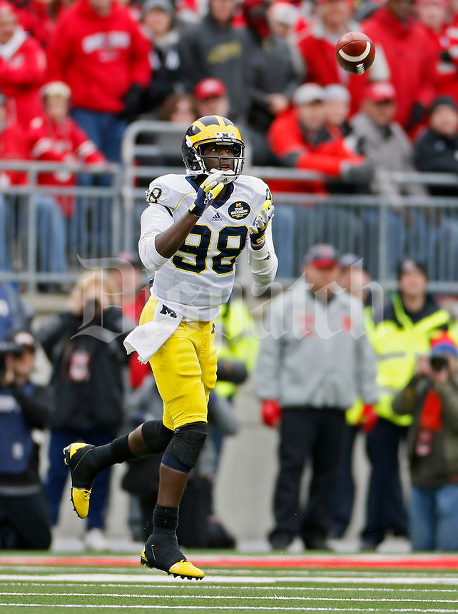 Michigan Wolverines quarterback Devin Gardner (98) comes up with a catch against Ohio State Buckeyes in the 3rd quarter of their game at Ohio Stadium in Columbus, Ohio on November 29, 2014.  (Dispatch photo by Kyle Robertson)